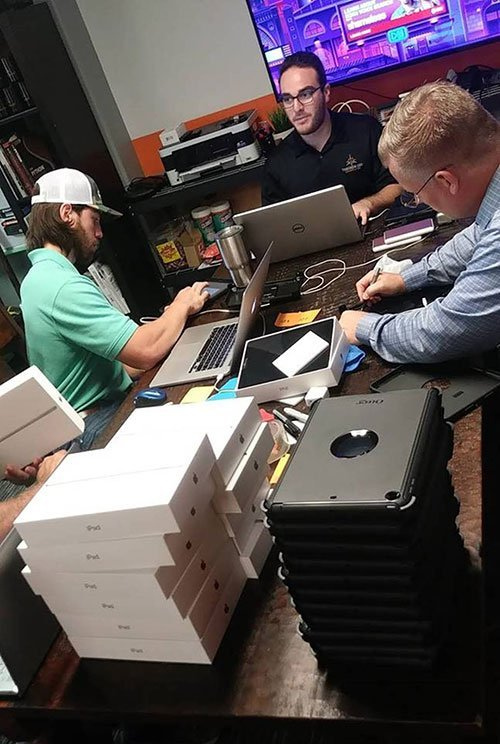 TGA Team preparing iPads for the response & recovery teams